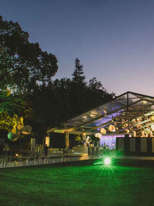 Marquee with lighting and walkway during the evening