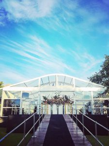 wedding marquee in front of blue skies