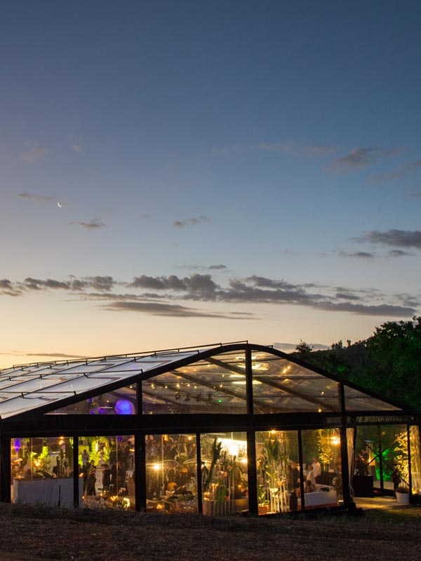 marquee structure at sunset